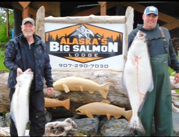 A pair of anglers hoist their bounty during an Alaska vacation.